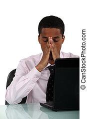 A black businessman having a headache.