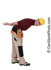 Builder bending over