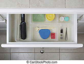 Organized Bathroom Drawer - Open bathroom drawer with...
