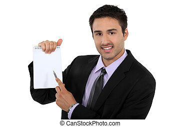 man pointing at his notepad