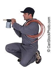 Man aiming a blowtorch