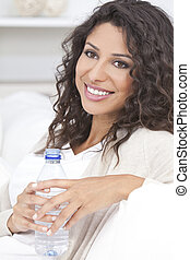 Happy Hispanic Woman Drinking Bottle of Water - Beautiful...