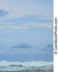 Waves Under Pastel Colored Skies - Waves wash to shore under...