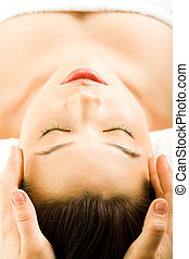 Facial massage - Image of pretty young woman getting a...