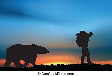 Extreme explorer: explorer and bear at the sunset