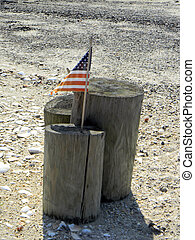 Wooden Pilars with American Flag - Trio of wooden pilars...