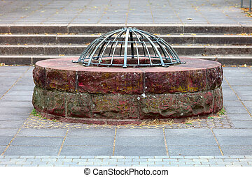 Old well - A old well on the castle ruin in city Saarburg,...