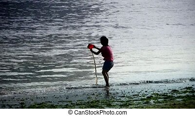 Little girl play digging sand at the beach.tide,tidal.