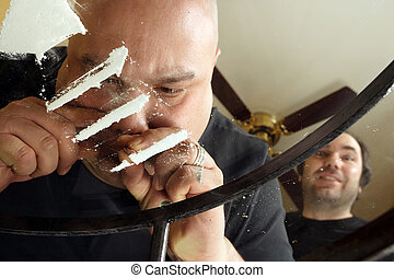Snorting cocaine - An Image of drug abuse. Male snorting...