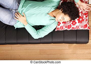 Jung brazilian woman sleeping on the sofa - A jung brazilian...