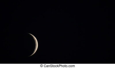 Young moon near horizon