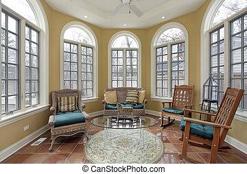Sunroom with terra cotta floors