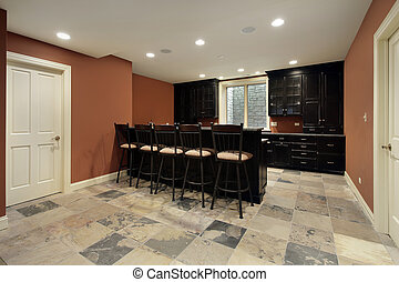 Bar in basement with dark wood cabinetry - Bar in basement...