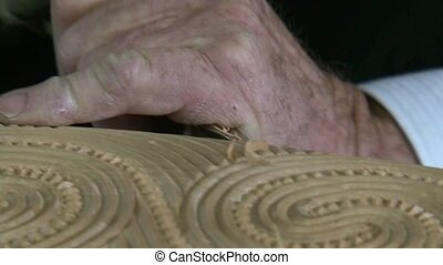 wood carver working with kauri timb - Matakohe, New Zealand...