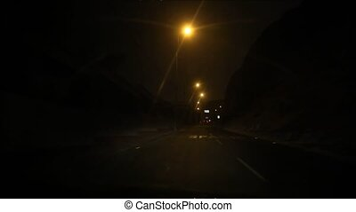 Car trip at night, Lima, Peru