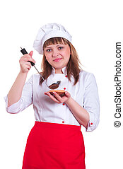 attractive woman cooking - Woman tries to cook cooked food