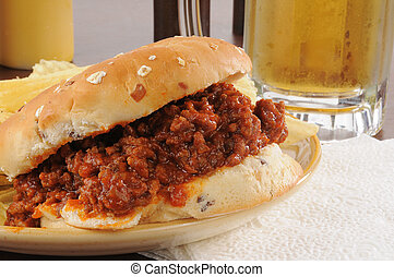 Sloppy joe and beer - Closeup of a sloppy joe hamburger and...