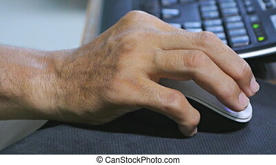 Hand holding mouse - Male hand holding computer mouse