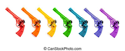 Toy plastic guns , on a white background - Colorful of...