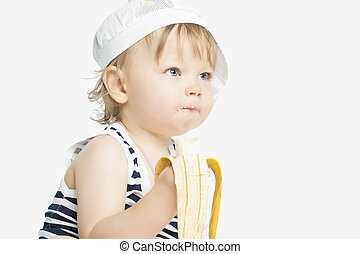 little caucasian girl eating banana - cute portrait of...