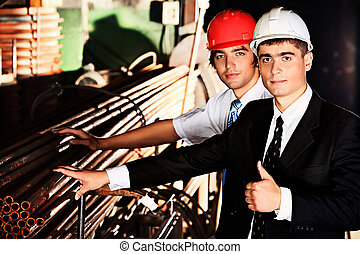 blue collar - Industrial theme: two blue collars at a...