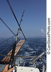 Fishing trip - A fishing rod on a fishing boat with deep...
