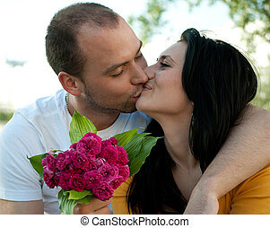 Closeup portrait young couple in love - Outdoors