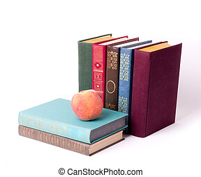 Stack of vintage books with peach