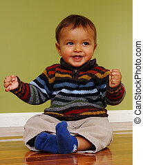 Sitting Baby - Cute 6-9 month old biracial boy happily...