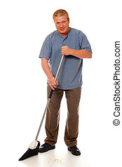 Sweeping Up - Man sweeping the floor.  Isolated on white.