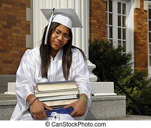 Studious Graduate - African American graduate in cap and...