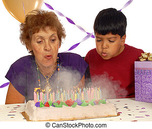 Blowing Out Eighty - A woman and her great grandson blowing...