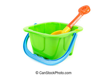 Kids green bucket and spade on white