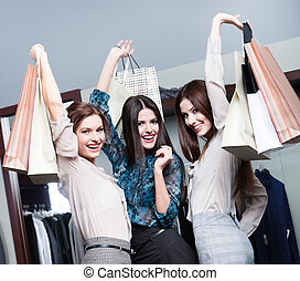 Three friends after shopping - Three friends are happy after...