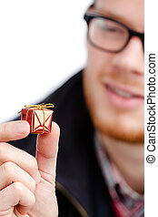 Man hands small toy present