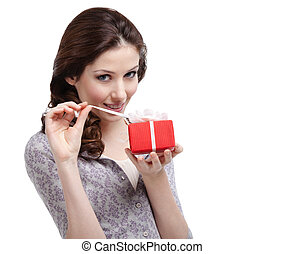 Young lady unwraps her gift - Young lady unwraps her...
