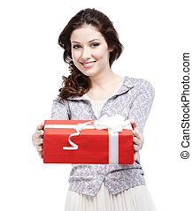 Young woman proffers a gift wrapped in red paper, isolated...
