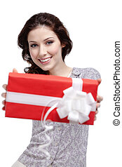 Young woman passes a gift wrapped in red paper, isolated on...