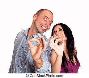 Man and woman smiling and showing you OK sign