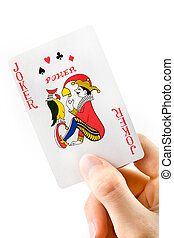Hand holding a joker playing card over white