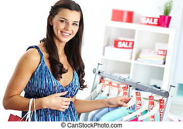 Shopper in clothing department - Portrait of happy woman...