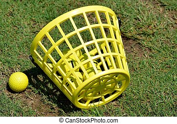 Driving Range Golfballs - Golfballs and basket at a practice...
