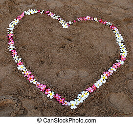 Flower heart on the beach - Flowers in the shape of love...