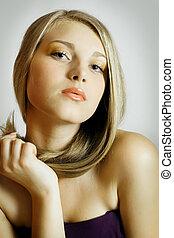Blond Fashion Girl. Blonde Hair. Golden tones