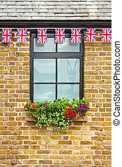 Window with Union Jack bunting above it