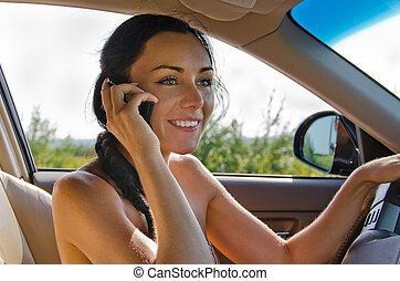 Woman driver talking on cellphone