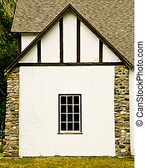 White Cottage - A white-walled cottage with stone