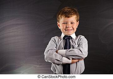 Cute boy against blackboard - Cute preschooler against dark...
