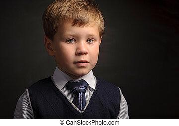 Pupil portrait - Cute pupil portrait against dark classroom...