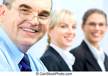 Face of senior - Image of faces of business people with boss...